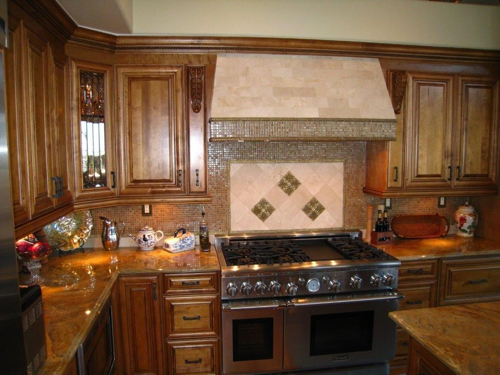 Kitchen cabinets with glass doors and raised panel doors