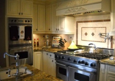 White kitchen cabinets with tile backsplash
