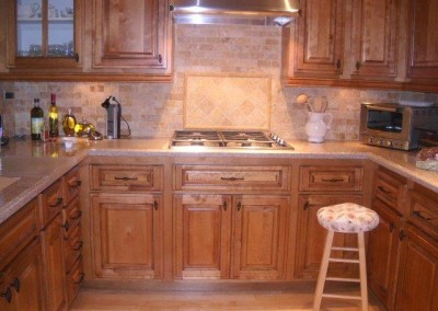 Maple kitchen cabinets with tile backsplash