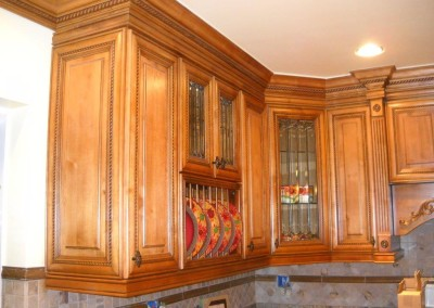 Custom kitchen with rope molding as cabinet trim.