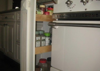 Pull out spice rack hidden behind fluting