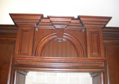 Added rope crown molding details to kitchen cabinets
