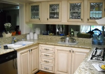 Antique white kitchen cabinets in Laguna Beach