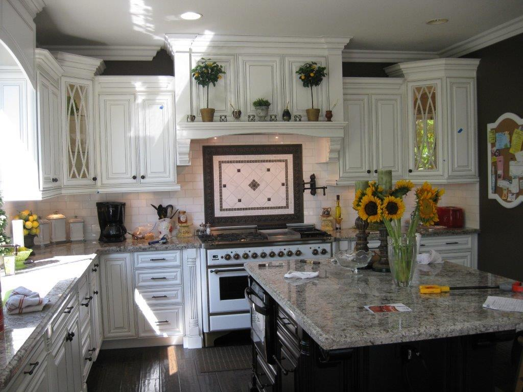 White kitchen cabinets with decorate glass doors