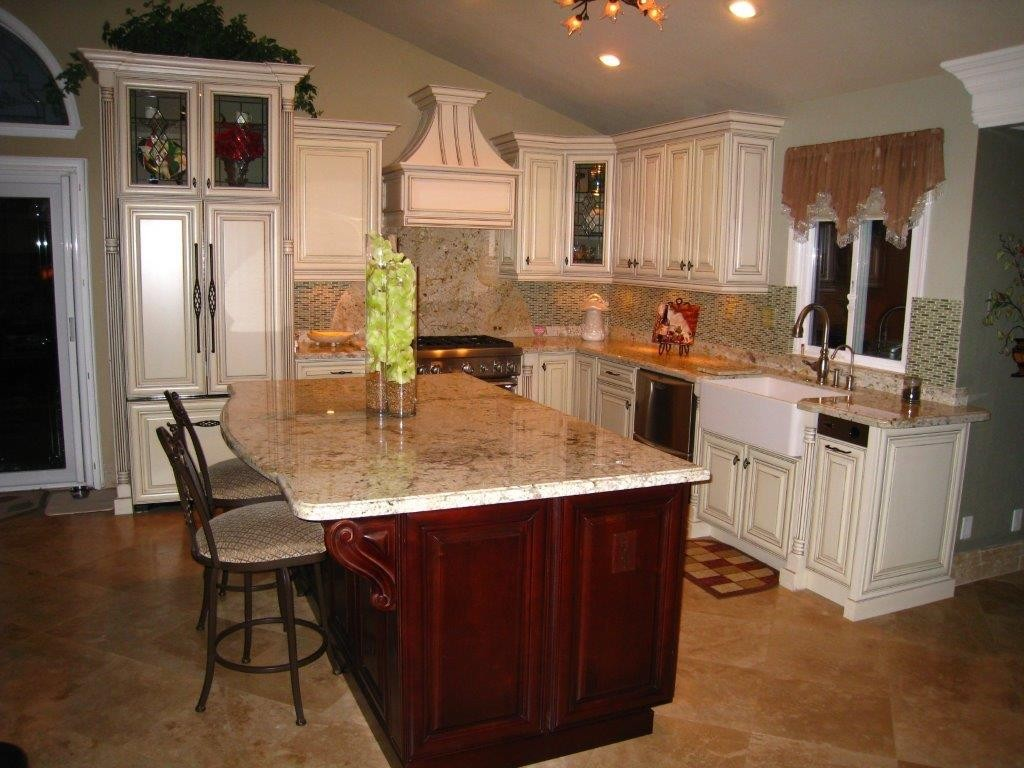 Ivory kitchen cabinets with dark island