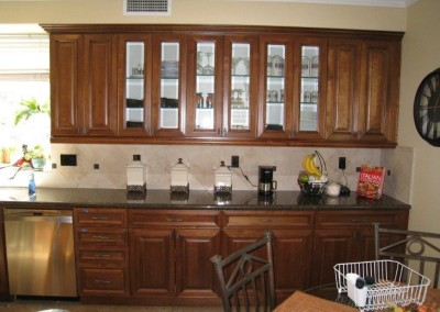 Custom kitchen cabinets with glass shelves