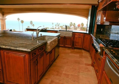 Gourmet kitchen with dual stone sinks and ocean view