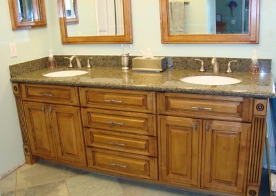 Bathroom vanity cabinets with fluting and granite counters