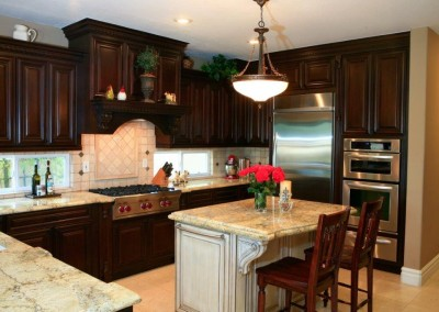 Dark kitchen cabinets with light antiqued island