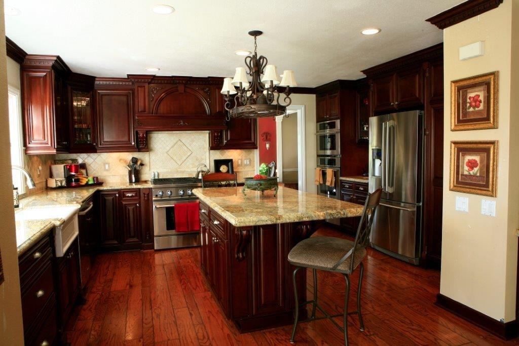 Medium maple cabinets with kitchen islannd