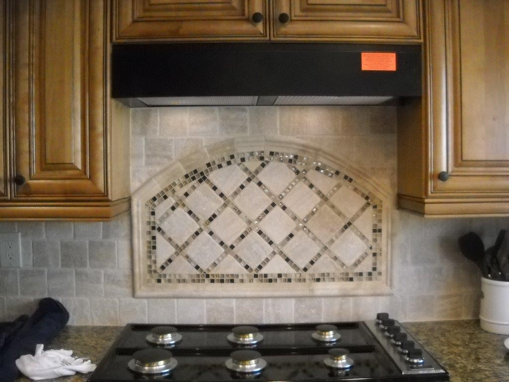 Kitchen cabinets with custom tile backsplash