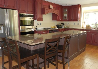 Stock kitchen cabinets with beadboard island in Santa Ana