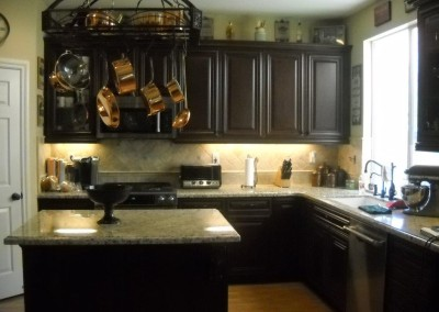 Dark kitchen cabinets with light granite countertop