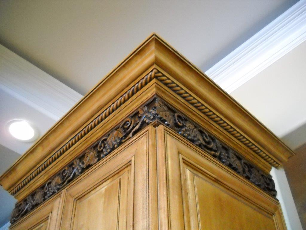 Decorative crown molding on custom kitchen cabinetry