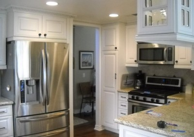 Bright white kitchen cabinets with raised panel doors