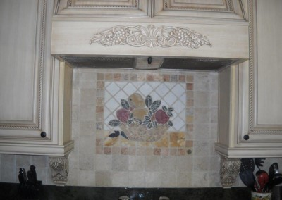 Decorative tile backsplash and custom kitchen hood.