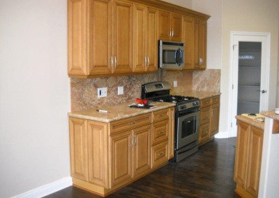 Pretty maple kitchen cabinets with granite counter