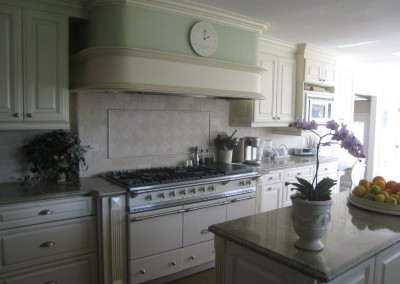 White kitchen cabinets with raised panel doors