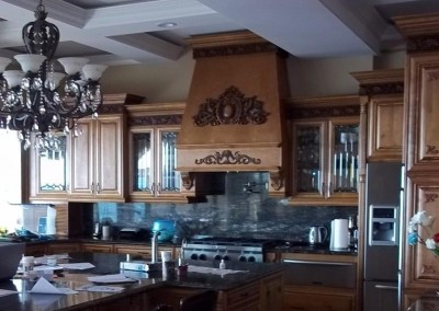 Maple kitchen cabinets with decorate glass doors.