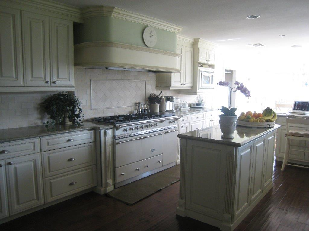 White Kitchen Cabinetry With Fluting And Raised Panel