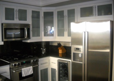 White ktichen cabinets with frosted glass doors