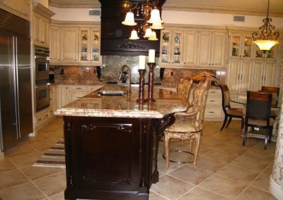 Antique white cabinets with dark kitchen island