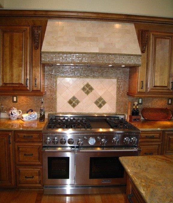 Glass tile backsplash with custom kitchen cabinetry