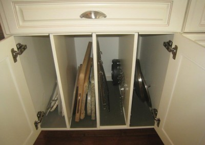 Kitchen cabinets with built in tray storage