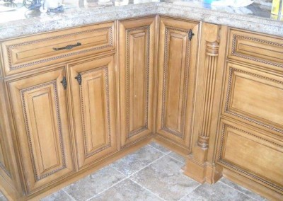 Kitchen cabinets with pillars and rope molding accents
