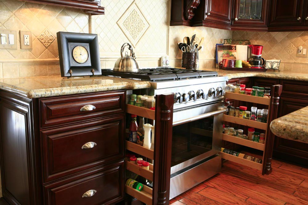 Kitchen Cabinet Trends Including Pull Out Spice Racks.