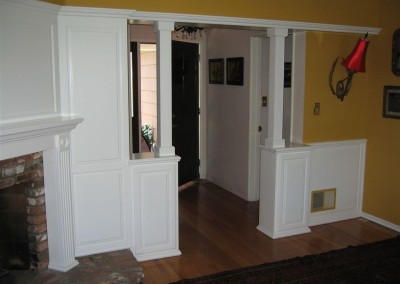 White entertainment center with wainscoting