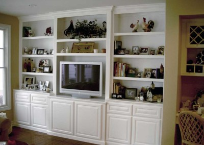 Custom white wall unit cabinet with bookshelves. A customer favorite in Southern California