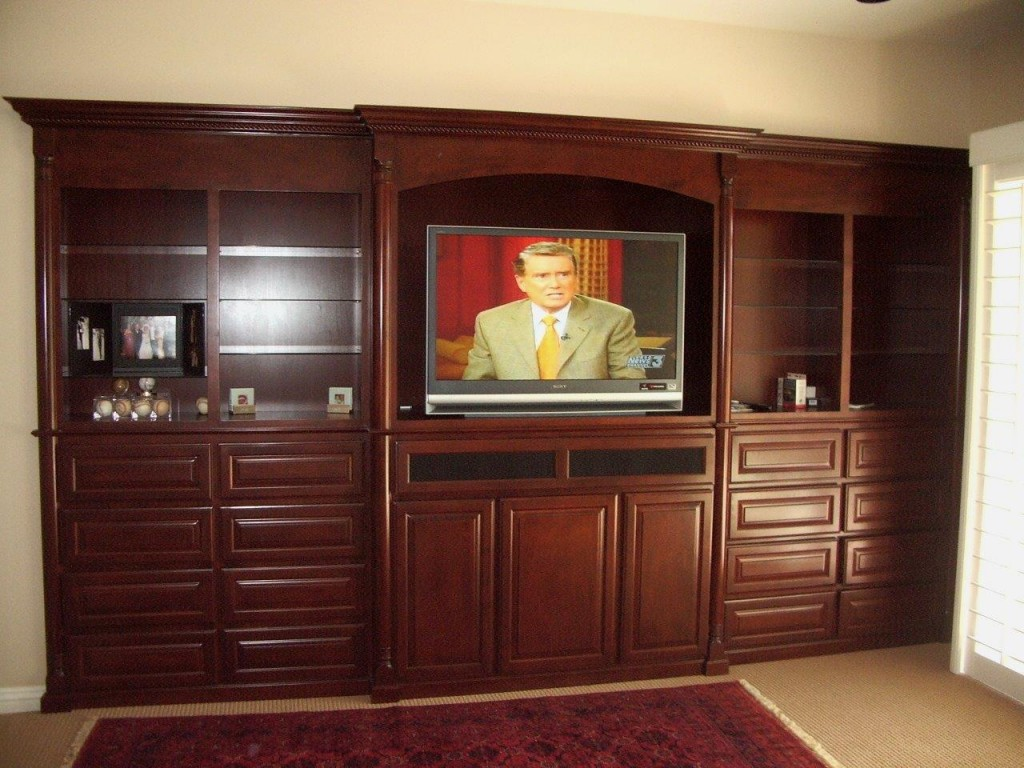 Custom Wall Units And Entertainment Centers · Built In Bedroom Cabinets