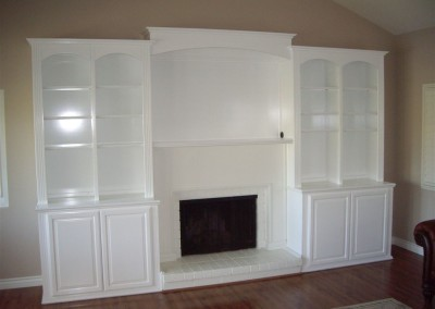 White entertainment center surrounds fireplace