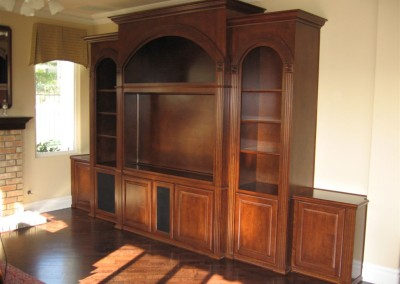 Graceful arches accent this custom cabinet