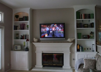White bookcases next to fireplace