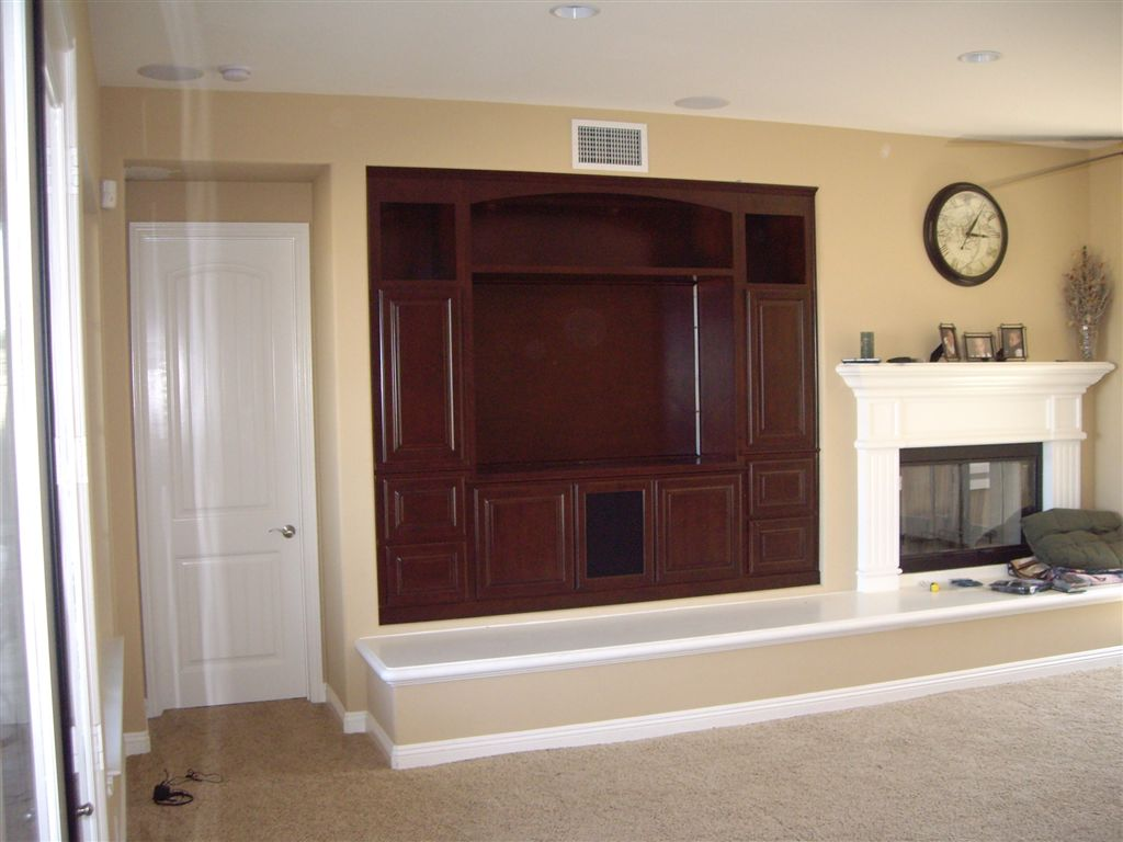 Charming Cabinets Built Into Wall Niche By Fireplace