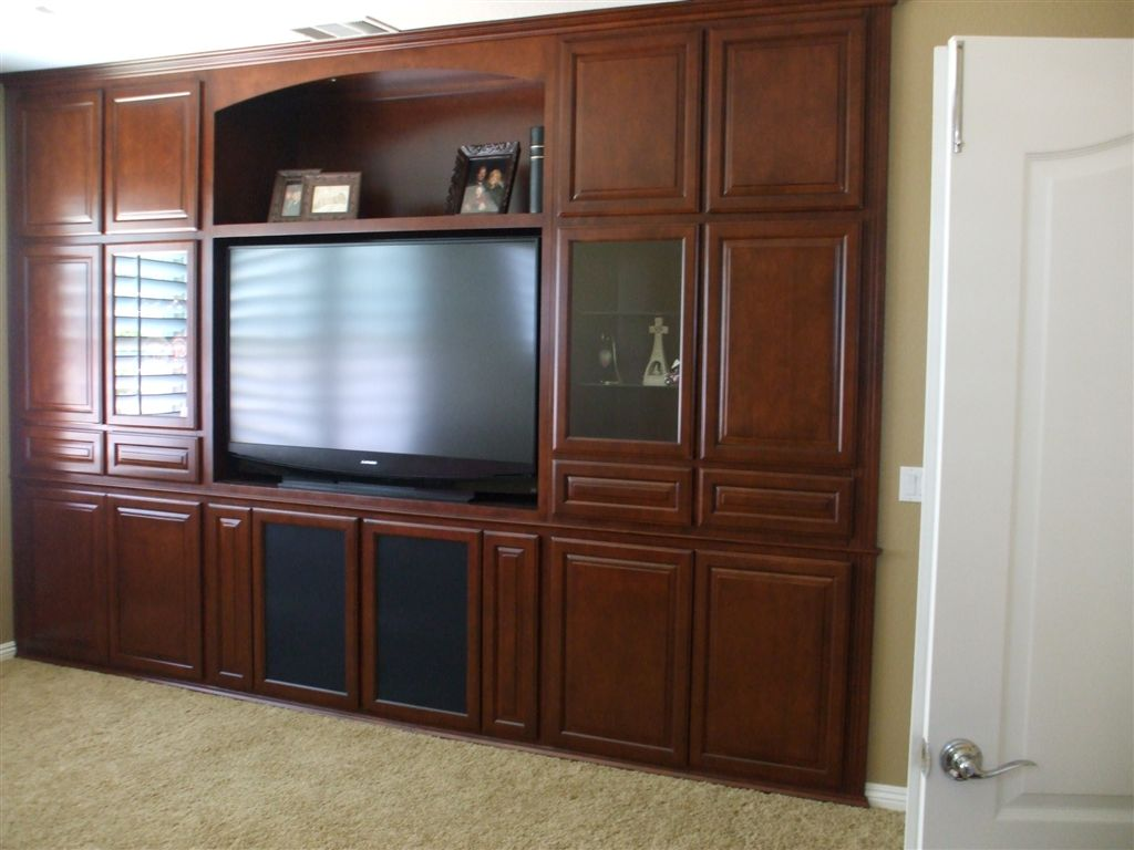 Watch the big game in style with a custom home theater cabinet for Custom built cabinets
