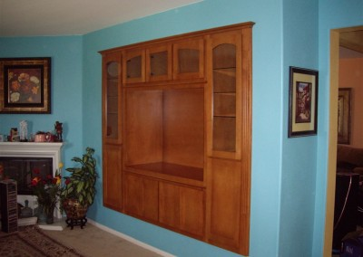 Honey color wall unit really pops on this blue wall