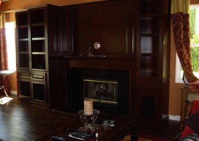 Entertainment center cabinets around fireplace