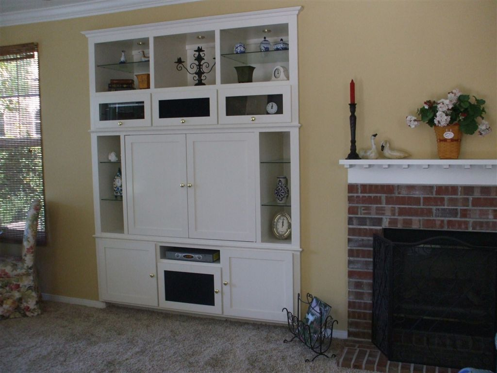 White entertainment center for your socal home for Built in wall units