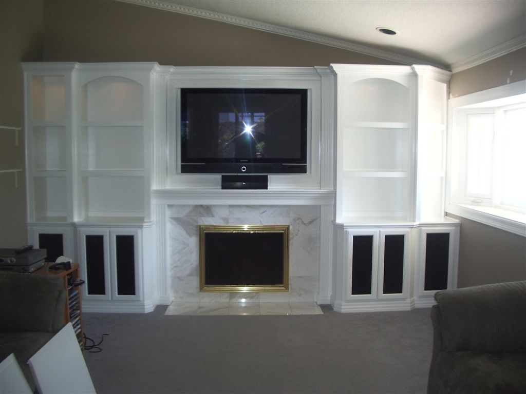 Watch the big game in style with a custom home theater cabinet for Large kitchen wall units