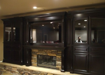 A class look with these built in cabinets around the fireplace