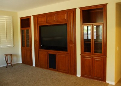 Custom entertainment center cabinet built into alcove