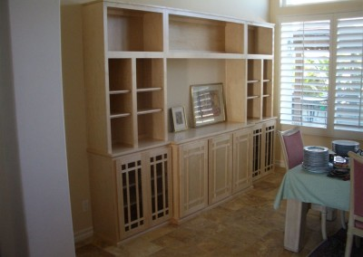 Light wood wall unit with shelves