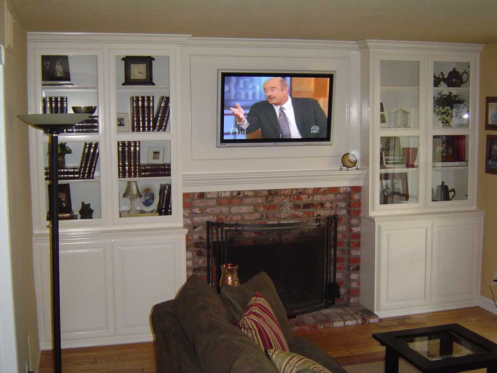 ... White entertainment center with TV over fireplace ... - White Entertainment Center For Your SoCal Home