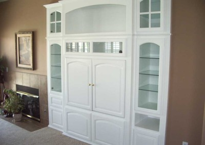 White entertainment center with glass shelves