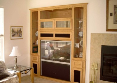 Light maple wall unit with glass doors and shelves