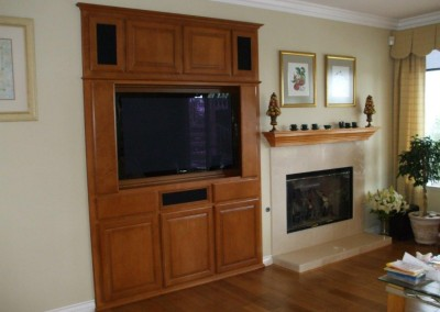 Maple entertainment center and  fireplace mantel in Westminster