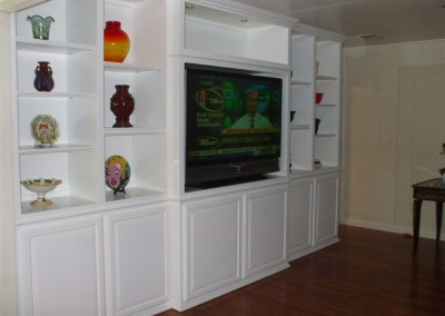 Custom white cabinets with bookshelves